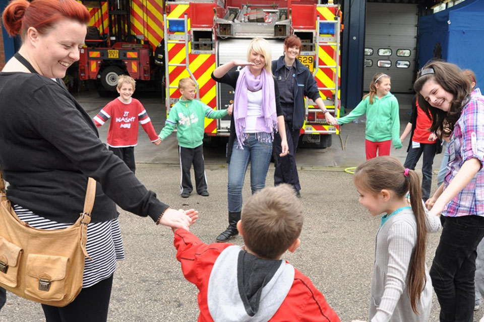 Parents and children at the Cheshire Fire Service safety event