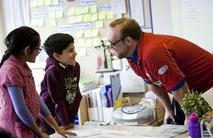 primary teacher talking to pupils