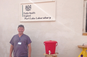 PHE staff member outside laboratory building