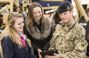Lance Corporal James Nash, 101 Regt Royal Engineers, talks to members of the public about the Army Reserve at Waterloo station [Picture: Sergeant Rupert Frere RLC, Crown copyright]