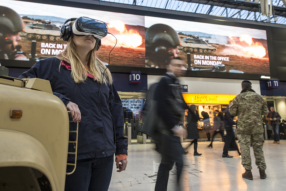 A member of the public tries out a virtual reality headset to get a taste of what life is like in the Army