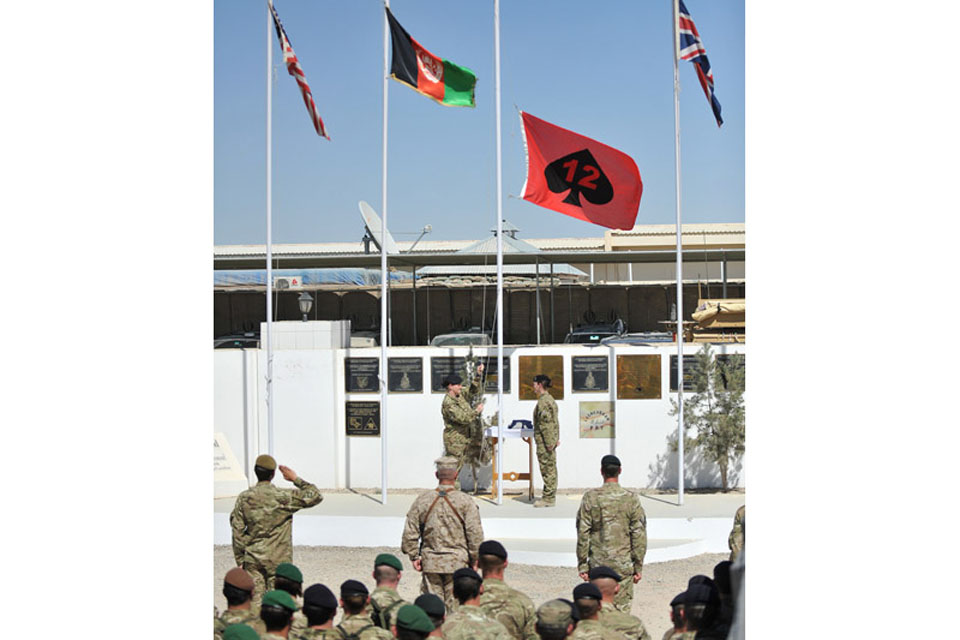 The 12 Mechanized Brigade flag is raised during the handover ceremony