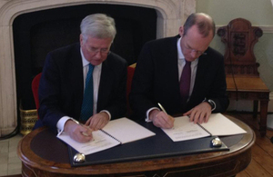 Michael Fallon and Simon Coveney signing a Memorandum of Understanding [Picture: Crown copyright]