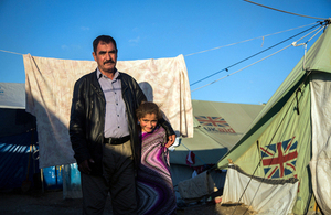 Zaido, 50, and his daughter, pictured outside their family's tents in an informal camp for Internally Displaced Persons in northern Iraq. Picture: Andrew McConnell/Panos for DFID