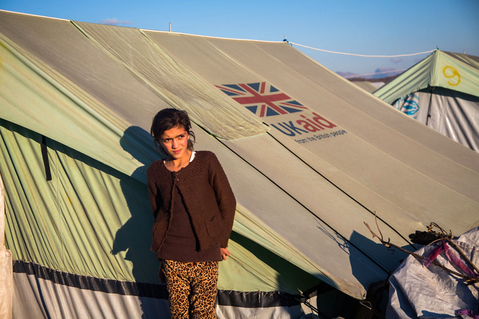 An Iraqi girl stands outside a UK aid tent at a camp for displaced people in nothern Iraq. Picture: Andrew McConnell/Panos for DFID