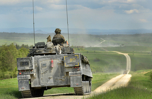 A British Army Warrior armoured infantry fighting vehicle patrolling down the live firing range in Grafenwöhr, Germany [Picture: Corporal Wes Calder RLC, Crown copyright]