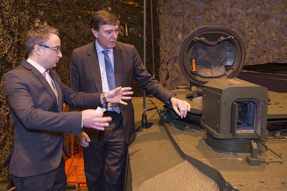 Adam Clark with Philip Dunne on a Challenger 2 tank