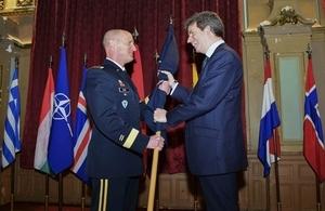 NATO General Petty handing over the NATO flag to UK Ambassador Ferguson