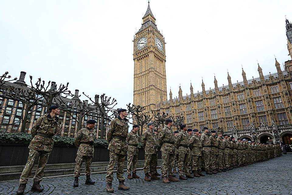 The last troops to serve on Operation Herrick line-up outside the Palace of Westminster