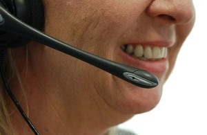 Person using telephone headset