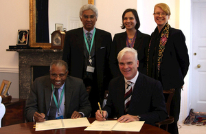 IDP President Dr Ahmad Mohamed Ali Al-Madani and International Development Minister Desmond Swayne sign a Memorandum of Understanding. Picture: DFID
