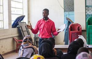 Adam Smith International adviser talking with community stakeholders in Kenya