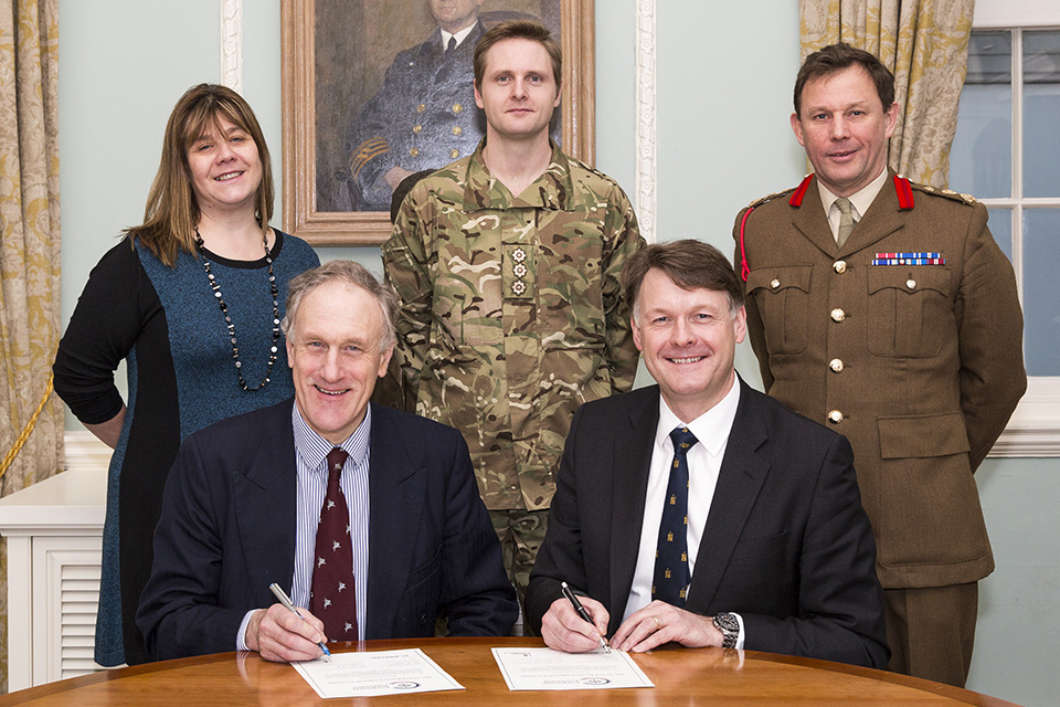 Julian Brazier MP and David Pitchforth, Managing Director of Boeing Defence UK Ltd signing the Corporate Covenant