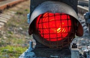 An image of railway track and signal light set to red.