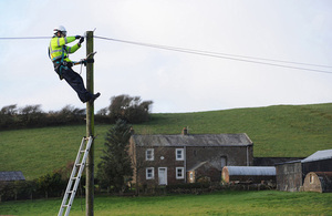 Engineer working on a telegraph pole
