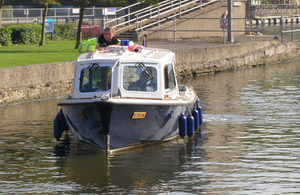 An Environment Agency waterways patrol of the River Medway in Kent