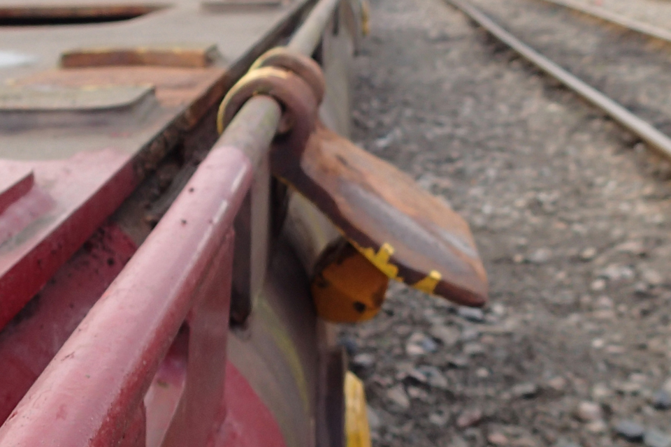 Hanging down from side of wagon (spigot similar to those fitted to the wagon involved in the accident)