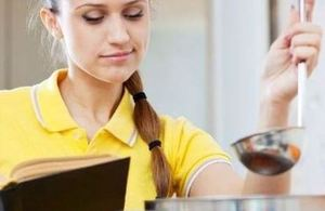 Image of girl in a yellow top with a cookbook ladle and spoon