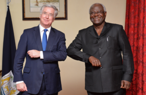 Defence Secretary Michael Fallon and His Excellency, President Ernst Bai Koromo, touch elbows for an 'Ebola handshake'.