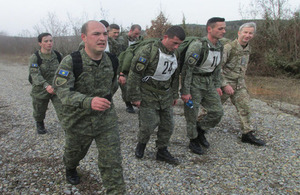 Candidates participate in a 12KM weight-carrying march around Ferizaj training area