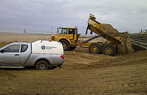 Transporting and tipping sand and shingle
