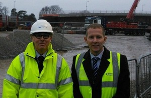 Mark Mosley from the Highways Agency and Wayne Poole from Manchester Airport in front of the new Thorley Lane bridge, ahead of it being lifted into place over the M56 this weekend.