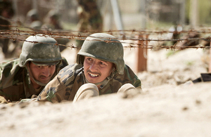Officer cadets from the Afghan National Army take part in an assault course designed to test their fitness and endurance, as part of the Kandak 1 training exercise at Kabul Military Training Centre (KMTC).
