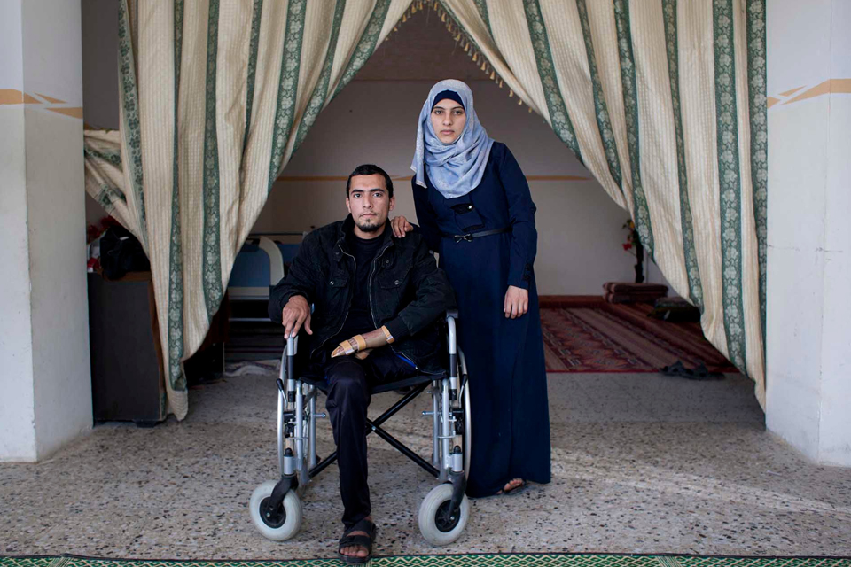 Abdullah and his fiancée at home in Gaza, 4 months after his operation. Picture: Abbie Trayler-Smith/Panos for DFID