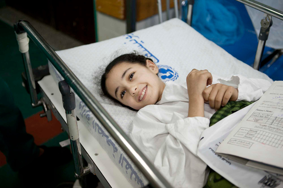 9-year-old Weam smiles as she waits to have an operation on her injured leg in Gaza's Shifa hospital. Picture: Abbie Trayler-Smith/Panos for DFID