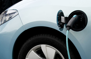 Image of a low carbon vehicle being charged up