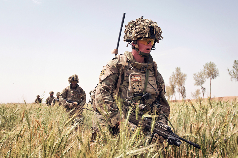 British soldiers patrol through a wheat field in Yakchal, Afghanistan