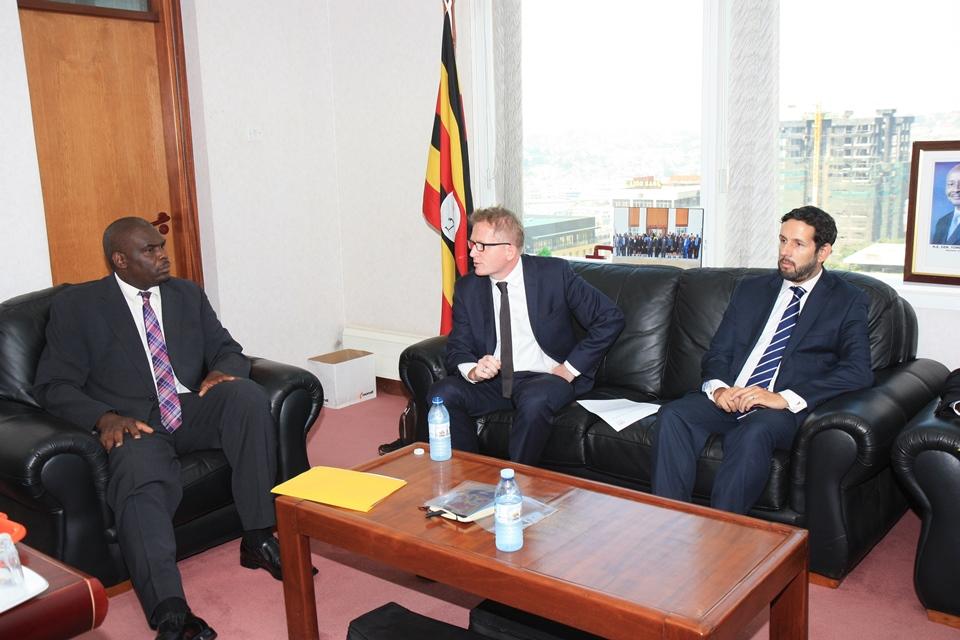 DPP's Justice Mike Chibita, DFID's Daniel Graymore and DFID Uganda's Alex Stevens