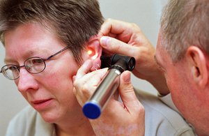 Woman having consultation with doctor. Ear examination.