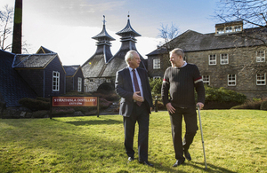 Francis Maude speaking to social entrepreneur Bruce Gunn at Strathisla distillery.
