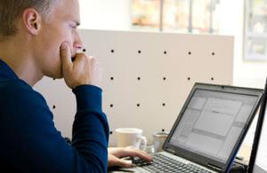Man looking at a laptop