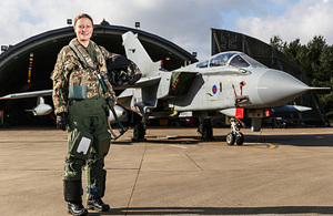 Wing commander Nikki Thomas stands in front of one of 12 (B) Squadrons Tornado GR-4 aircraft [Picture: Senior Aircraftman Andy Wright RAF, Crown copyright]