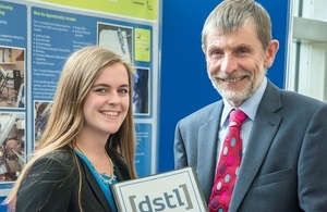 Emma Treadwell receiving her apprenticeship graduation certificate from Dstl Chief Executive Jonathan Lyle