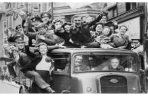 People in a truck celebrating VE Day