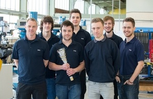 Dstl apprentices with the torch.