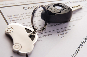 Car keys on top of documents.