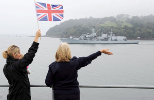 A wave and a cheer for HMS Argyll from loved ones gathered at Devil's Point in Plymouth to see the frigate off on a six-month tour of duty