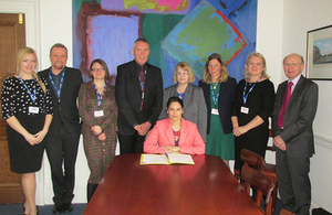 Priti Patel signs the memorandum of understanding.