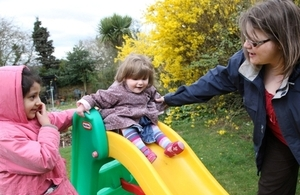 Children on slide with carer