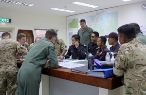 British Garrison and the Brunei Fire and Rescue Department meeting to discuss fire fighting efforts