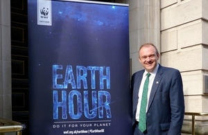 Edward Davey with the Earth Hour 2015 banner.