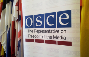 OSCE banner and flags