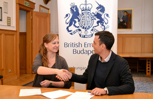 Director of Amnesty International Hungary, Orsolya Jeney, and Head of Policy Team at the British Embassy in Budapest, Ben Luckock, signing the sponsorship agreement