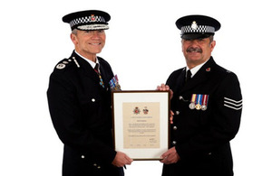 Neill getting his commendation from the Chief