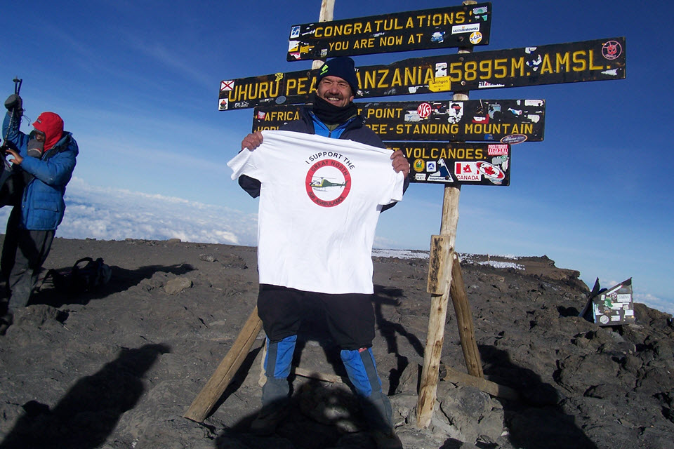 Neill at the top of Kilimanjaro