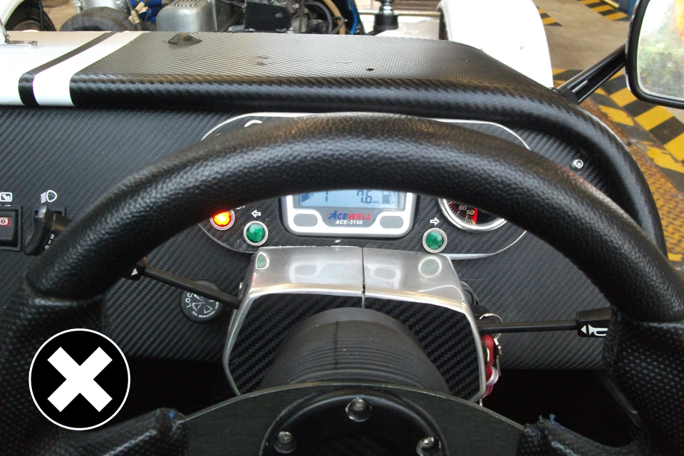 Now allowed: view of speedometer hidden from the driver.